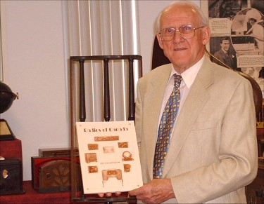 Lloyd Swackhammer with his book